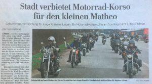 Zeitungs-Schlagzeile über einen verbotenen Motorrad-Korso